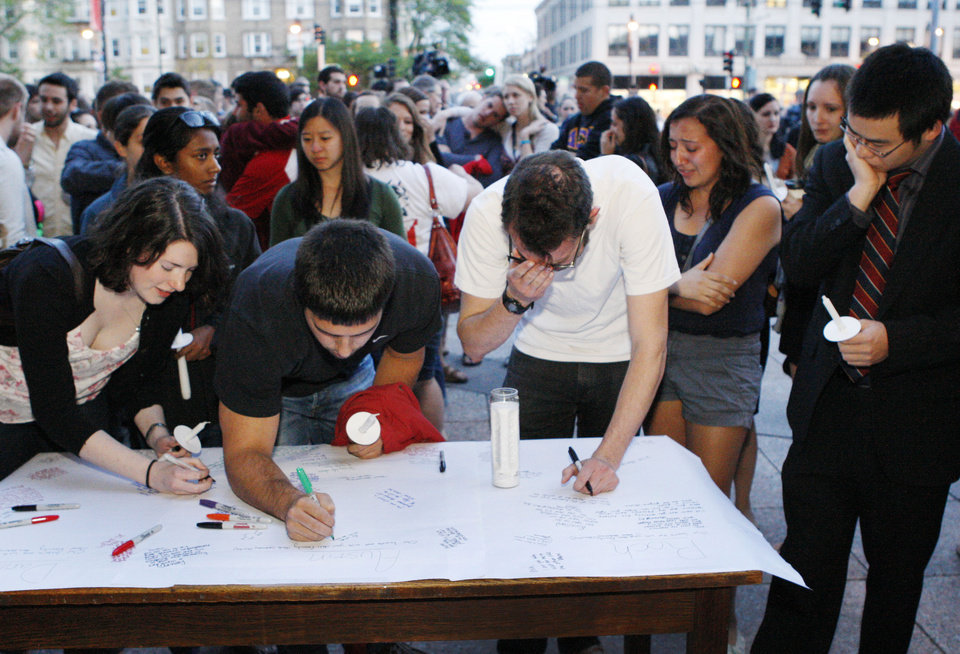 Photo -   Boston University students gather to sign a condolence note prior to a candlelight vigil on Marsh Plaza at Boston University, Saturday, May 12, 2012, in Boston, for three students studying in New Zealand who were killed when their minivan crashed during a weekend trip. At least five other students were injured in the accident, including one who was in critical condition. Boston University spokesman Colin Riley said those killed in the accident were Daniela Lekhno, 20, of Manalapan, N.J.; Austin Brashears, 21, of Huntington Beach, Calif.; and Roch Jauberty, 21, whose parents live in Paris. (AP Photo/Bizuayehu Tesfaye)