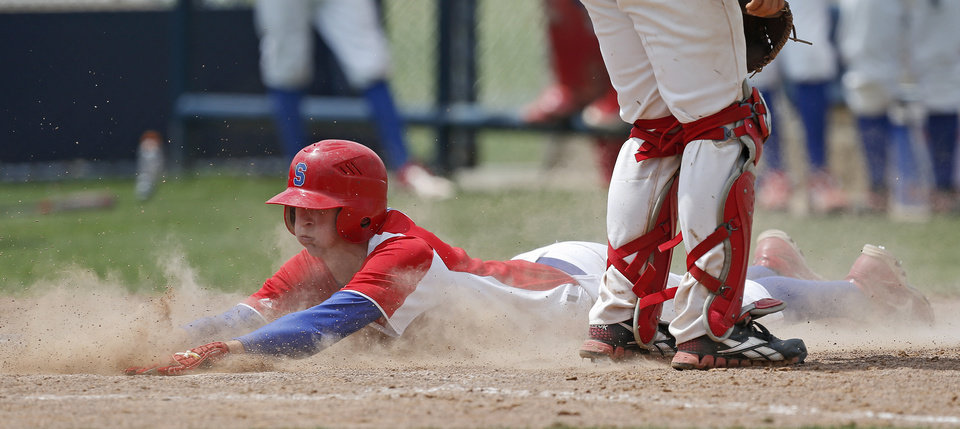 Silo's Lance House slides home to score in the third inning of a Class 2A state baseball tournament game against Caney Valley in Shawnee, Okla., Friday, May 10, 2013. Photo by Bryan Terry, The Oklahoman