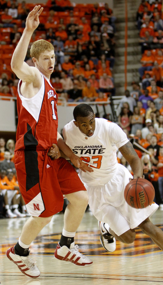 Photo - OSU's James Anderson drives by NU's Brandon Ubel during the college basketball game between Oklahoma State University and Nebraska at Gallagher-Iba Arena in Stillwater Saturday, March 6, 2010. Photo by Doug Hoke, The Oklahoman  ORG XMIT: KOD
