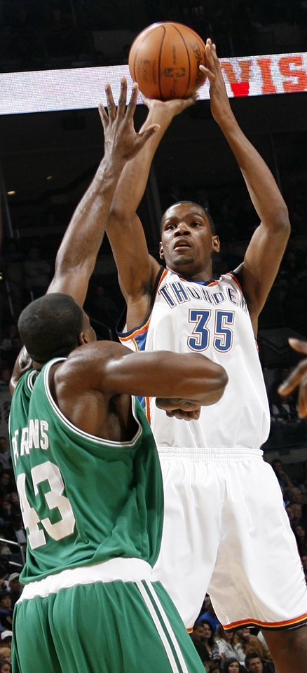 Photo - Kevin Durant (35) of Oklahoma City shoots over Kendrick Perkins (43) of Boston in the first half of the NBA basketball game between the Boston Celtics and the Oklahoma City Thunder at the Ford Center in Oklahoma City, Friday, Dec. 4, 2009. Photo by Nate Billings, The Oklahoman ORG XMIT: KOD