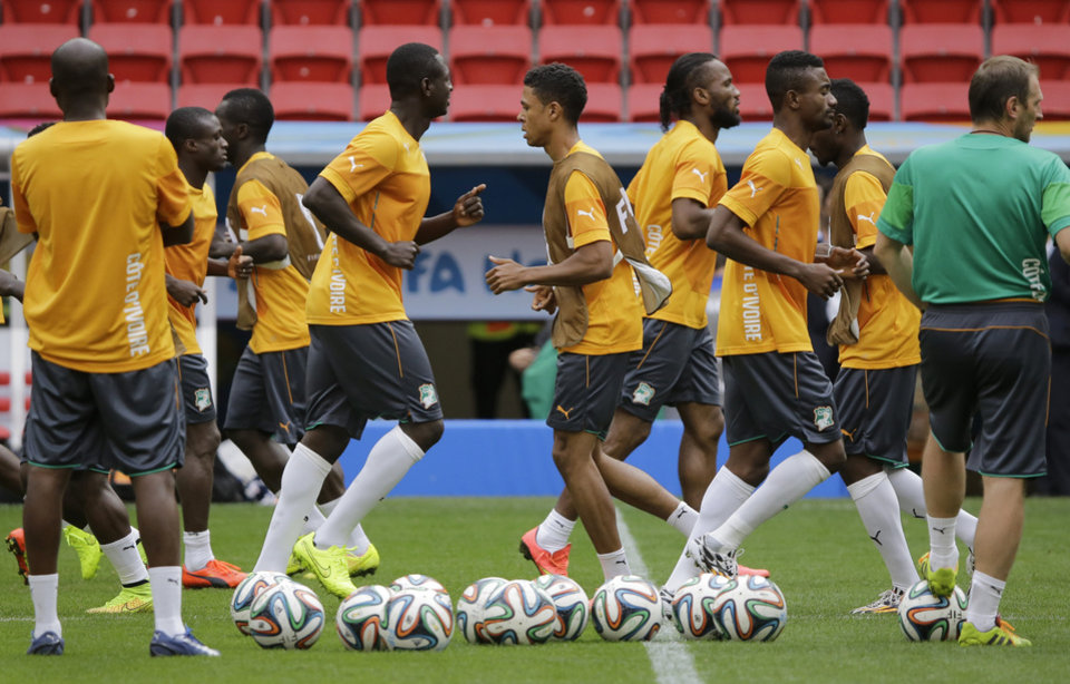 Photo - Ivory Coast soccer players practice drills during a training session at the Estadio Nacional in Brasilia, Brazil, Wednesday, June 18, 2014. Ivory Coast plays in group C of the 2014 Brazil soccer World Cup. (AP Photo/Sergei Grits)