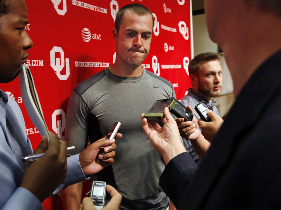 Landry Jones (12) speaks to the press at a media availability for the University of Oklahoma Sooner (OU) football team following practice on Tuesday, Aug. 21, 2012 in Norman, Okla.  Photo by Steve Sisney, The Oklahoman