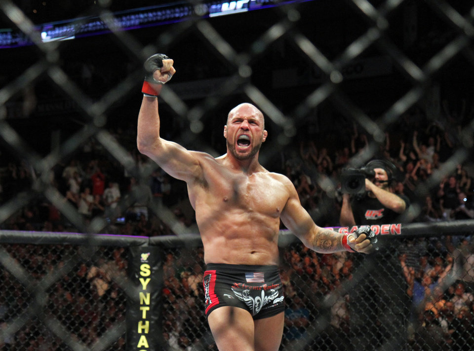 Photo -  Randy Couture celebrates his win against James Toney during their UFC fight at Boston's TD Garden in 2010. [AP FILE PHOTO]