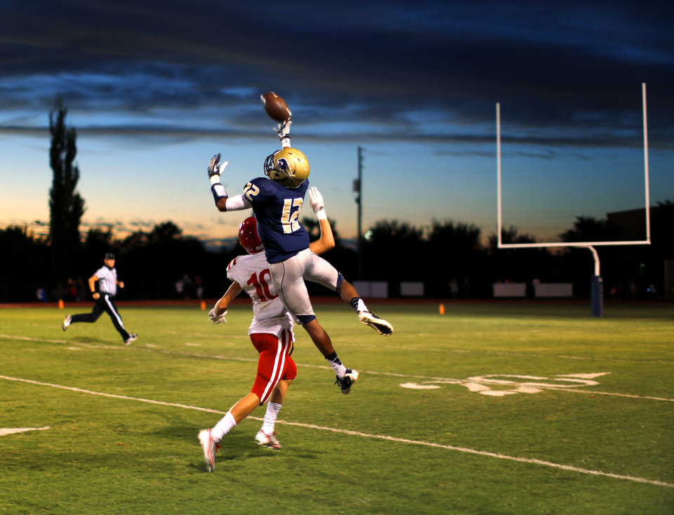 Photo - Heritage Hall's Domonique James leaps for a pass intended for Drew Melton of Davis during their high school football game in Oklahoma City, Friday, Sept. 20, 2013. Photo by Bryan Terry, The Oklahoman