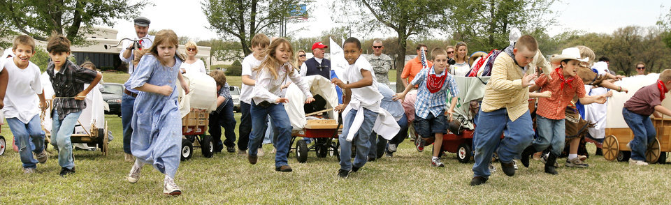 Photo - RE-ENACT / RE-ENACTMENT: Third-graders from Chisholm Elementary School participate in a land run re-creation in Oklahoma City Friday, April 24, 2009. Chisholm is in the Edmond Public School District. Photo by Paul B. Southerland, The Oklahoman ORG XMIT: KOD