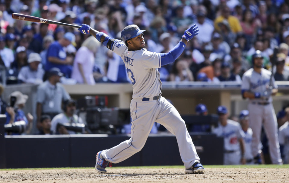 Photo - Los Angeles Dodgers' Hanley Ramirez watches his home run to right field against the San Diego Padres in the ninth inning of a baseball game won 3-1 by the Dodgers after they hit back-to-back home runs in San Diego, Sunday, June 23, 2013. (AP Photo/Lenny Ignelzi)