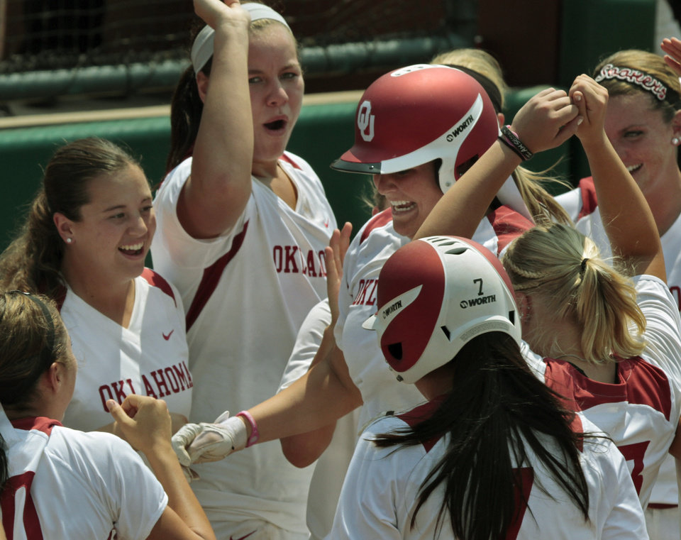 Katie Norris is greeted at home after a home run as the University of Oklahoma (OU) softball team plays Arizona in a super regional matchup at Marita Hines Field at OU on Friday, May 25, 2012, in Norman, Okla.  Photo by Steve Sisney, The Oklahoman