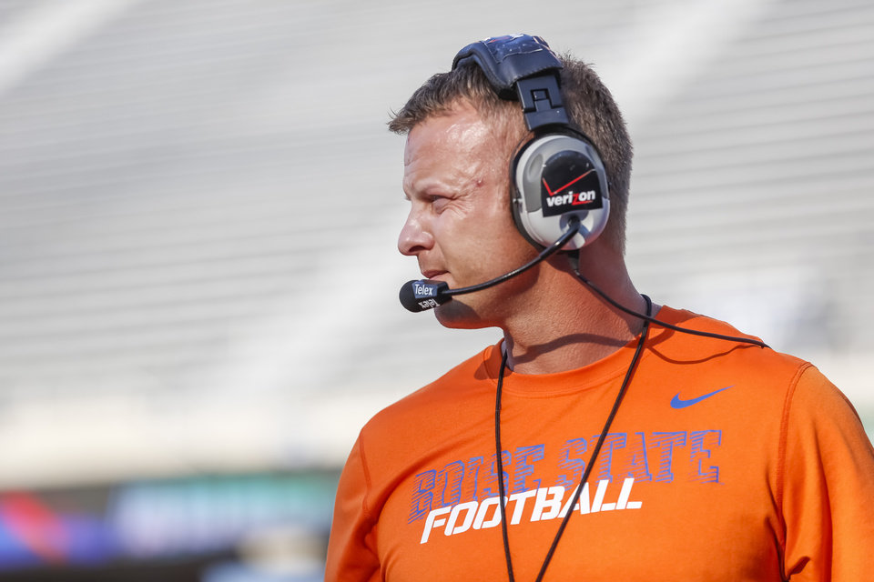 Photo - FILE - In this Aug. 15, 2014, file photo, Boise State head coach Bryan Harsin watches the action during the NCAA college football team's scrimmage in Boise, Idaho. Harsin is back at Boise State, after Chris Petersen left for Washington. His task now is to figure out how to keep the Broncos relevant on the national scene. (AP Photo/Otto Kitsinger, File)
