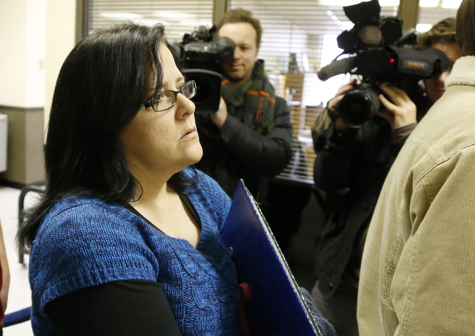 Jennifer Luna, the mother of murder suspect Chancey Luna, waits in line to enter the courtroom for a hearing Tuesday in Duncan. AP PHOTO <strong>Sue Ogrocki - AP</strong>