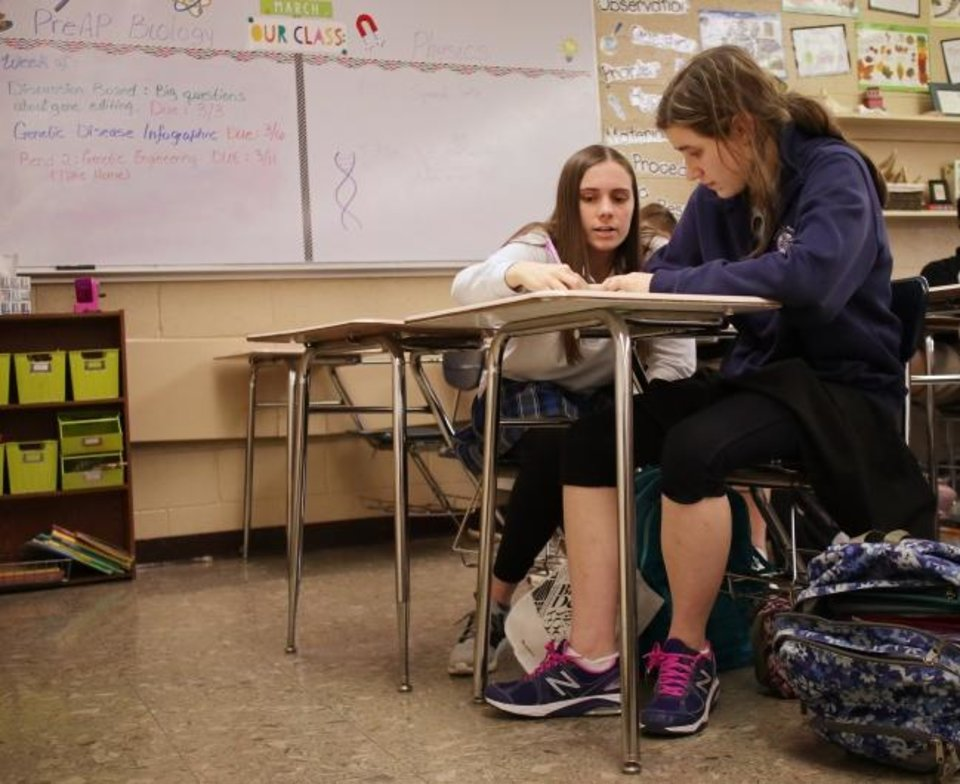 Photo -  Abagail Rogers works with her mentor Jordan Kernke during a class at Mount St. Mary High School in south Oklahoma City. [Doug Hoke/The Oklahoman]