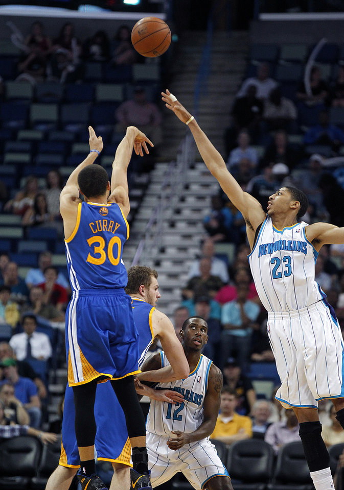 Golden State Warriors guard Stephen Curry (30) shoots over New Orleans Hornets forward Anthony Davis (23) in the second half of an NBA basketball game in New Orleans, Monday, March 18, 2013.  The Warriors won 93-72. (AP Photo/Gerald Herbert)