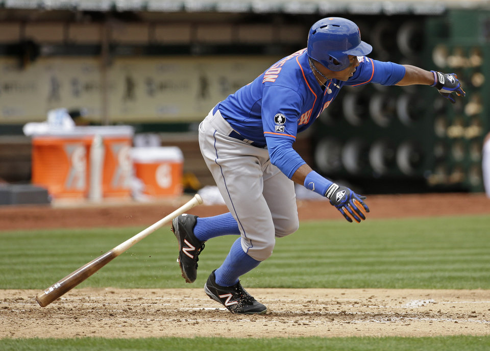 Photo - New York Mets' Curtis Granderson hits an RBI single off Oakland Athletics starting pitcher Jeff Samardzija in the fourth inning of their interleague baseball game Wednesday, Aug. 20, 2014, in Oakland, Calif. The Mets' Wilmer Flores scored on the play. (AP Photo/Eric Risberg)
