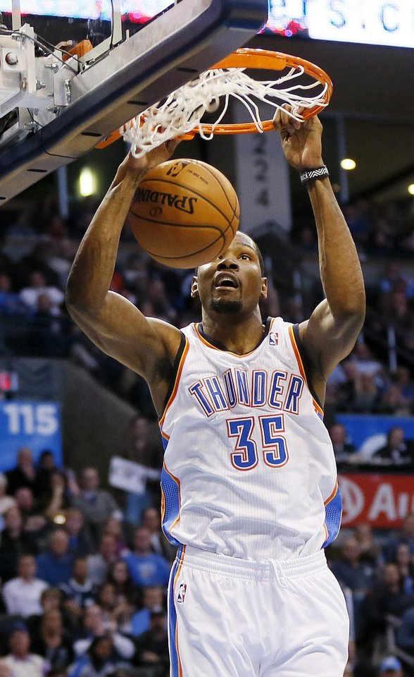 Oklahoma City's Kevin Durant (35) dunks the ball during an NBA basketball game between the Oklahoma City Thunder and the San Antonio Spurs at Chesapeake Energy Arena in Oklahoma City, Wednesday, Nov. 27, 2013. Photo by Nate Billings, The Oklahoman