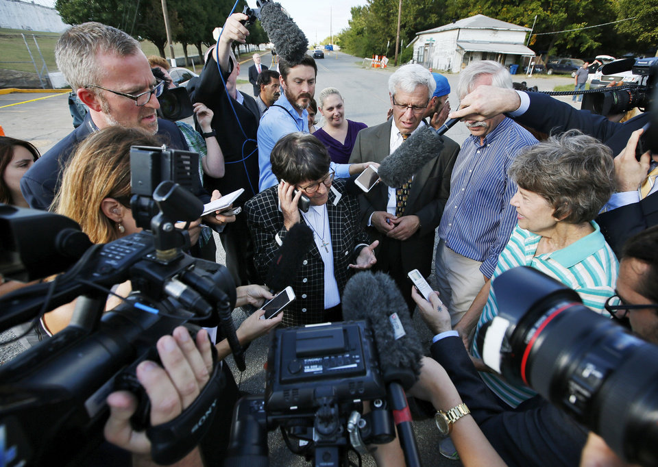 Photo - Sister Helen Prejean, middle, talks on the phone to death row inmate Richard Glossip after his scheduled execution was stayed at the Oklahoma State Penitentiary in McAlester, Okla., Wednesday, Sept. 30, 2015. Gov. Fallin stayed Richard Eugene Glossip's execution for 37 days. Photo by Nate Billings, The Oklahoman