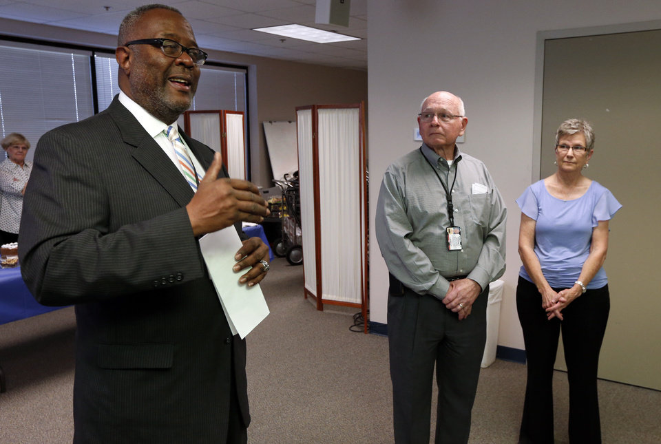 Photo -  Jim Spearman, center, and wife, Judy, are lauded by Norman Police Chief Keith L. Humphrey at Spearman's retirement party. He retired after 45 years of service to the department. PHOTO BY STEVE SISNEY, THE OKLAHOMAN   STEVE SISNEY -