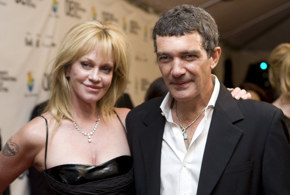 Photo - FILE - This Sept. 7, 2008 file photo shows actors Antonio Banderas, right, and his wife Melanie Griffith at the Gala premier of