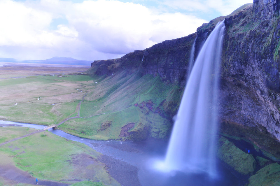 Photo - This 2011 photo provided by Vanessa Giacoppo shows a waterfall in Iceland. Giacoppo took the photograph on a private tour of Iceland with a guide, Tony Prower, who takes visitors to waterfalls and other scenic spots where they can shoot beautiful pictures. Private tours are a growing industry, no longer the exclusive domain of wealthy travelers, thanks to websites that help tourists connect with locals. (AP Photo/Vanessa Giacoppo)