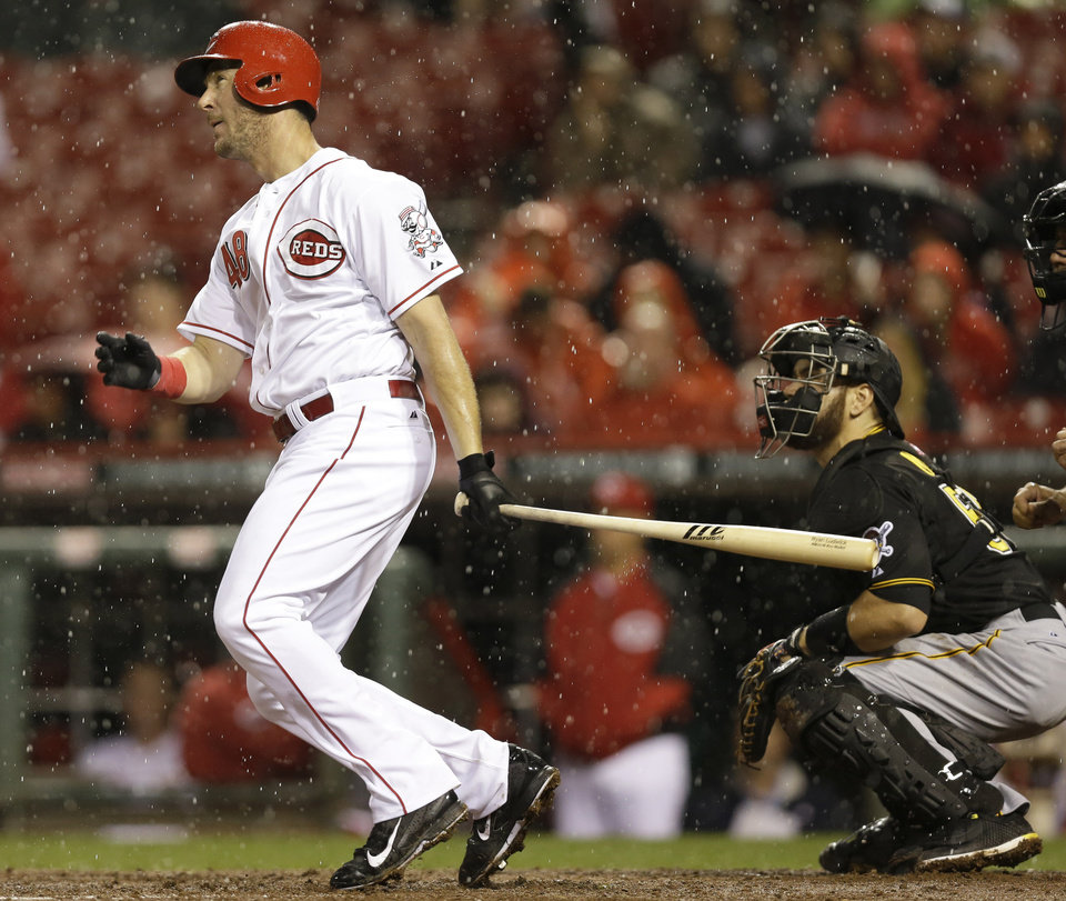 Photo - Cincinnati Reds' Ryan Ludwick hits a two-run home run off Pittsburgh Pirates starting pitcher Wandy Rodriguez in the fourth inning of a baseball game, Monday, April 14, 2014, in Cincinnati. (AP Photo/Al Behrman)