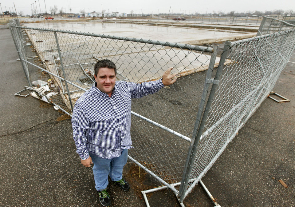 Former General Manager Jon Fisher stands at the corner of what used to be the AMF Moore Bowl in Moore, OK, Friday, December 13, 2013,  Photo by Paul Hellstern, The Oklahoman