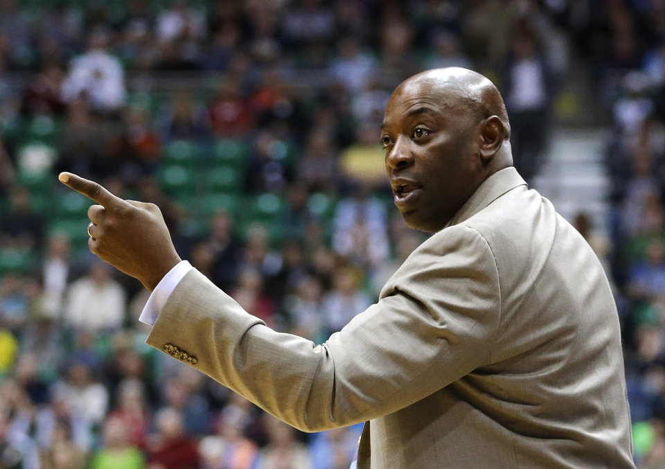 Photo - Sacramento Kings head coach Keith Smart disputes a call with an official in the second quarter during an NBA basketball game against the Utah Jazz Monday, Feb. 4, 2013, in Salt Lake City. (AP Photo/Rick Bowmer)