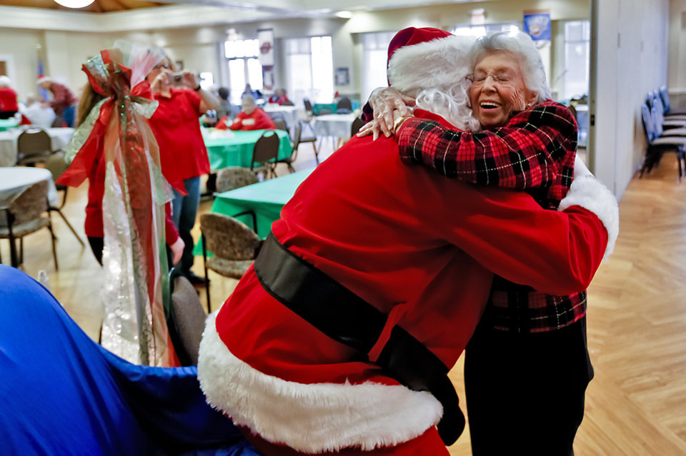 Verlin Wood, 99, gives a hug to Santa Claus as Santa made a visit to the Edmond Senior Center on Friday, Dec. 7, 2012, in Edmond, Oklahoma. Photo by Chris Landsberger, The Oklahoman