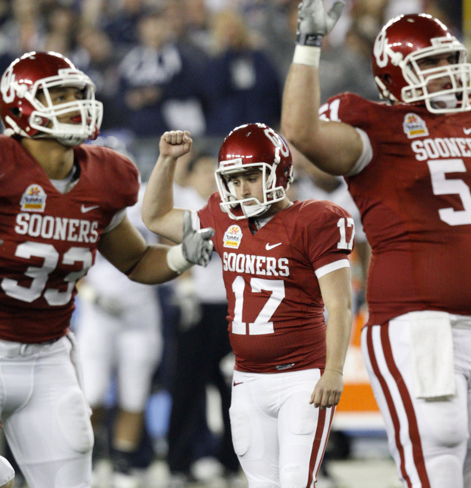 Photo - Oklahoma's Jimmy Stevens  (17) reatcs after making a field goal during the Fiesta Bowl college football game between the University of Oklahoma Sooners and the University of Connecticut Huskies in Glendale, Ariz., at the University of Phoenix Stadium on Saturday, Jan. 1, 2011.  Photo by Bryan Terry, The Oklahoman