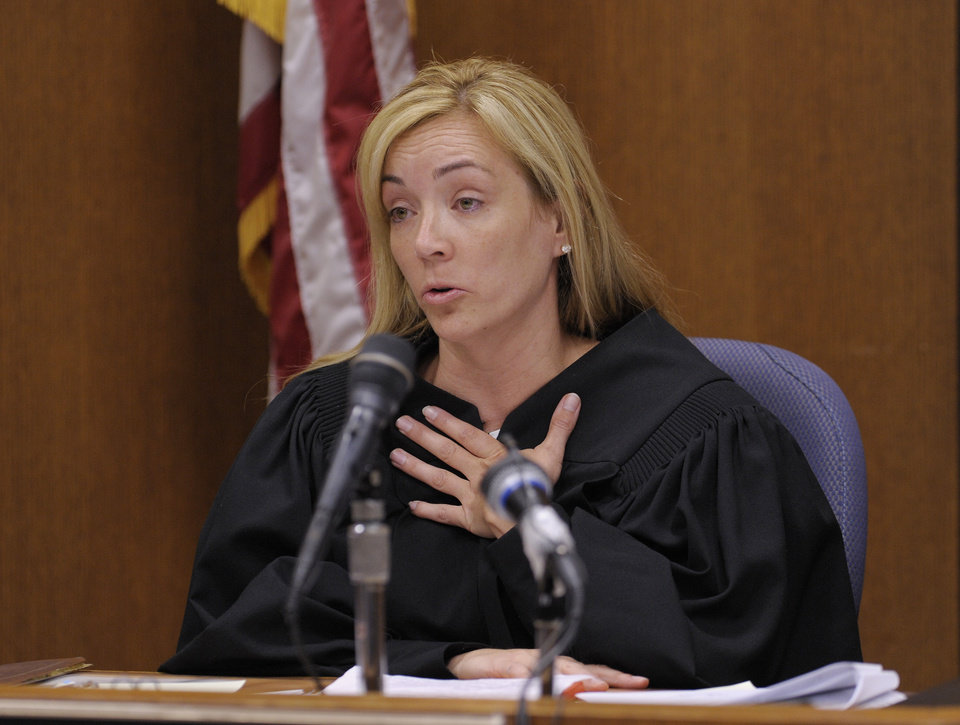 Photo - Judge Dana Hathaway speaks during the sentencing hearing for Theodore Wafer, Wednesday, Sept. 3, 2014, 2014, in Detroit. Wafer was sentenced to at least 17 years in prison on Tuesday for killing an unarmed Renisha McBride on his porch. During the trial, he said he shot the 19-year-old because he feared for his life, but a jury rejected Wafer's claim of self-defense. (AP Photo/Detroit News, Clarence Tabb Jr.)  DETROIT FREE PRESS OUT; HUFFINGTON POST OUT, MANDATORY CREDIT