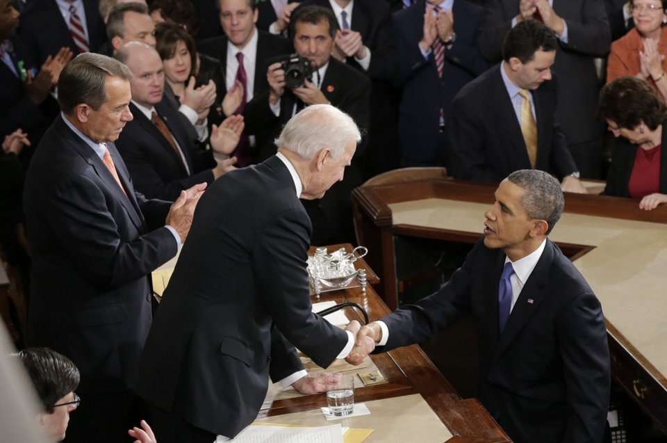 Photo - President Barack Obama shakes hands with Vice President Joe Biden after the president gave his State of the Union address during a joint session of Congress on Capitol Hill in Washington, Tuesday Feb. 12, 2013. House Speaker John Boehner of Ohio is at left. (AP Photo/J. Scott Applewhite)