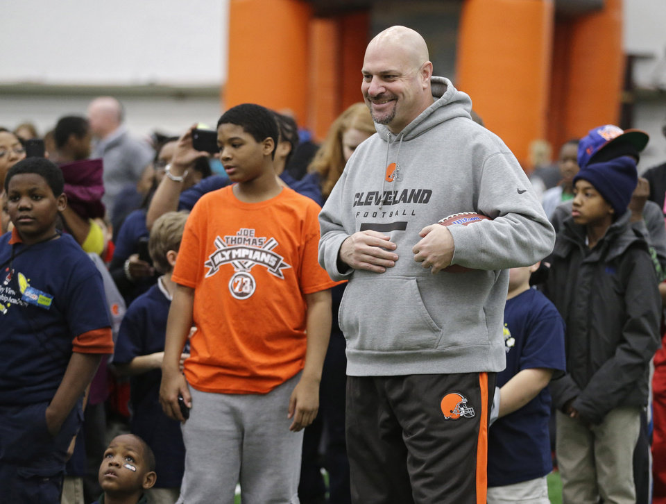 Photo - Cleveland Browns head coach Mike Pettine meets area Special Olympians at the NFL team's Play 60 football festival at their practice facility in Berea, Ohio, Thursday, Feb. 13, 2014. Pettine replaced Mike Chudzinski who was fired after the 2013 season. (AP Photo/Mark Duncan)