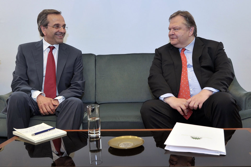 Photo -   Leader of the New Democracy conservative party Antonis Samaras, left, meets with Evangelos Venizelos, the head of the Socialist PASOK party at the Greek parliament, in Athens, on Monday, June 18, 2012. Samaras, who came first in Sunday's national election, said he will meet with leaders of all parties