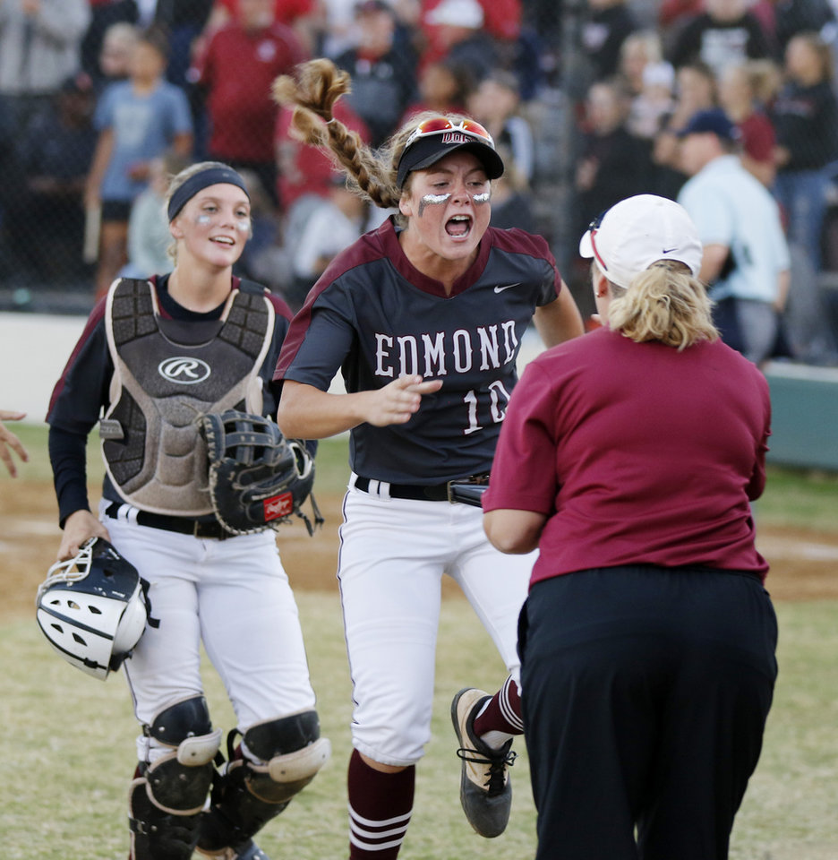 Photo - EHS #10 Emerson Heron comes off the field jumping during the 6A Fast Pitch Championship game between Edmond Memorial and Owasso at the Ball Fields at Firelake in Shawnee, Saturday, October 19, 2019. [Doug Hoke/The Oklahoman]