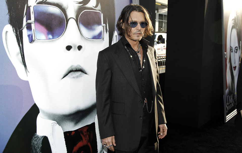 Photo -   Cast member Johnny Depp arrives at the premiere of