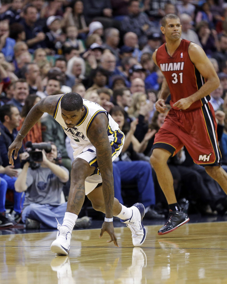 Utah Jazz\'s Marvin Williams (2) celebrates after hitting a 3-pointer while Miami Heat\'s Shane Battier (31) looks away during the first quarter of an NBA basketball game Saturday, Feb. 8, 2014, in Salt Lake City. (AP Photo/Rick Bowmer)