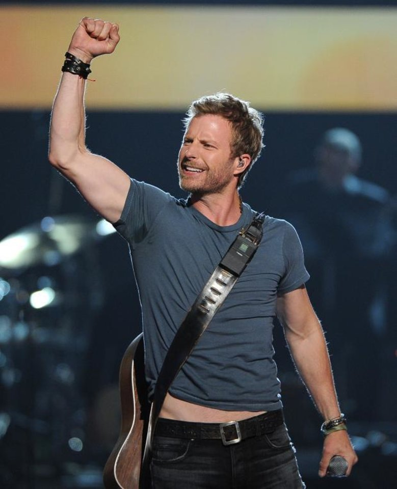 "Photo -  Dierks Bentley performs at ""ACM Presents an All-Star Salute to the Troops"" on Monday, April 7, 2014, in Las Vegas. (AP)"
