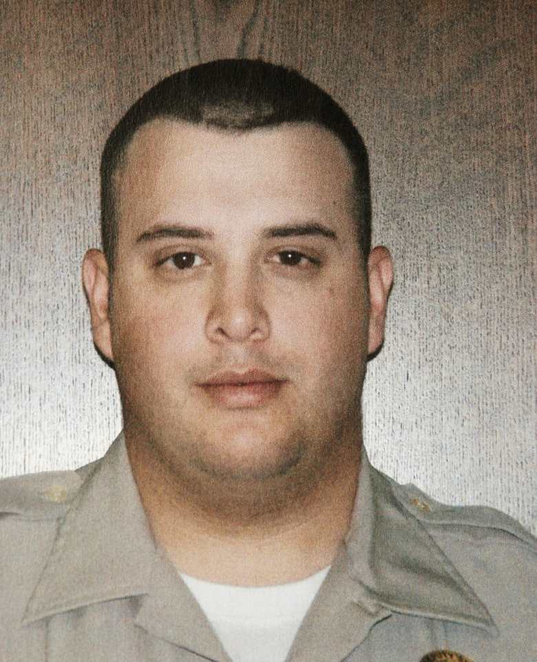 Photo - Handout photo of Seminole County deputy Robbie Chase Whitebird, one of two deputies gunned down Sunday. Ezekiel Holbert, 26,charged with their mdeaths.