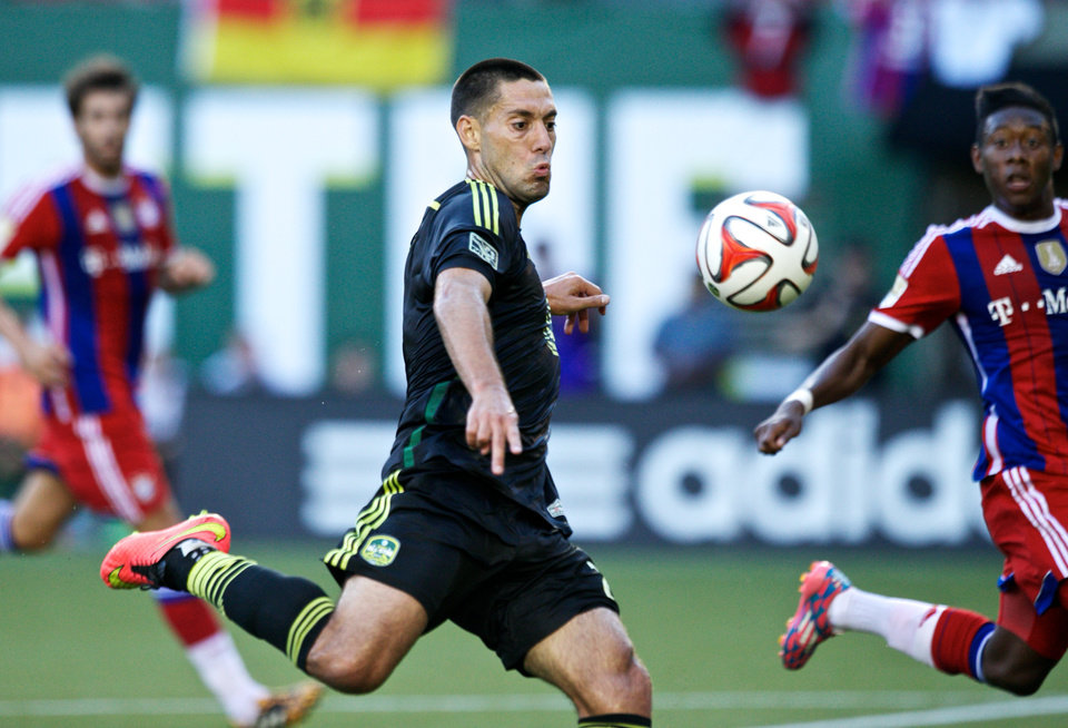 Photo - MLS All Stars' Clint Dempsey, of the Seattle Sounders, takes a shot against Bayern Munich during the MLS All-Star soccer game, Wednesday, Aug. 6, 2014, in Portland, Ore. (AP Photo/The Oregonian, Thomas Boyd)