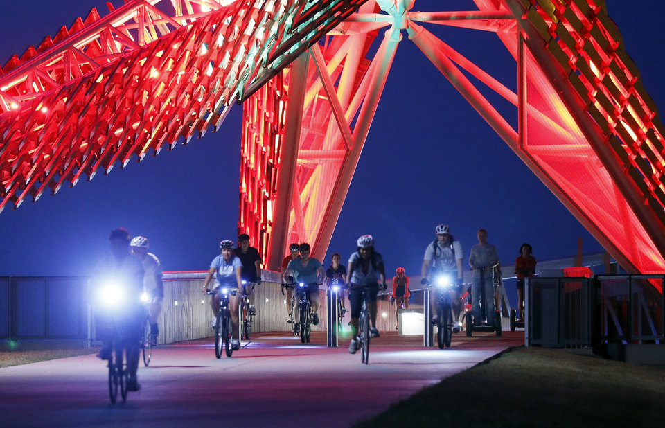 Cyclists pass over the SkyDance bridge during a Full Moon Bicycle Ride organized by the Myriad Gardens and Schlegel Bicycles in Oklahoma City, Monday, July 22, 2013. The next moonlight ride will be Tuesday, August 20, at 9pm starting at the Myriad Gardens\' bandshell. Photo by Nate Billings, The Oklahoman