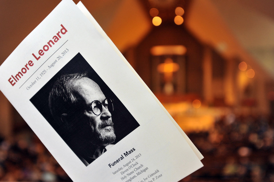 A black and white portrait of beloved novelist Elmore Leonard graces the program for his funeral mass inside Holy Name Church in Birmingham, Mich., Saturday Aug. 24, 2013. Leonard died Tuesday at his home in Bloomfield Village at age 87.  (AP Photo/The Detroit News, John T. Greilick)