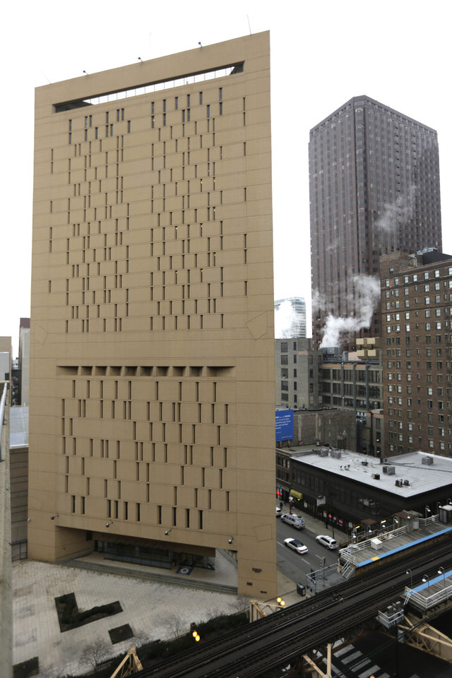Photo - This photo shows the Metropolitan Correctional Center Tuesday, Dec. 18, 2012, in Chicago. Two convicted bank robbers used a knotted rope or bed sheets to escape from the federal prison window high above downtown Chicago early Tuesday, a week after one of them made a courtroom vow of retribution, to federal judge. The escape occurred sometime between 5 a.m. and 8:45 a.m. when the inmates were discovered missing, Chicago Police Sgt. Mark Lazarro said. Hours later, what appeared to be a rope, knotted at six-foot intervals, could be seen dangling into an alley from a window of the Metropolitan Correctional Center approximately 20 stories above the ground. (AP Photo/M. Spencer Green)