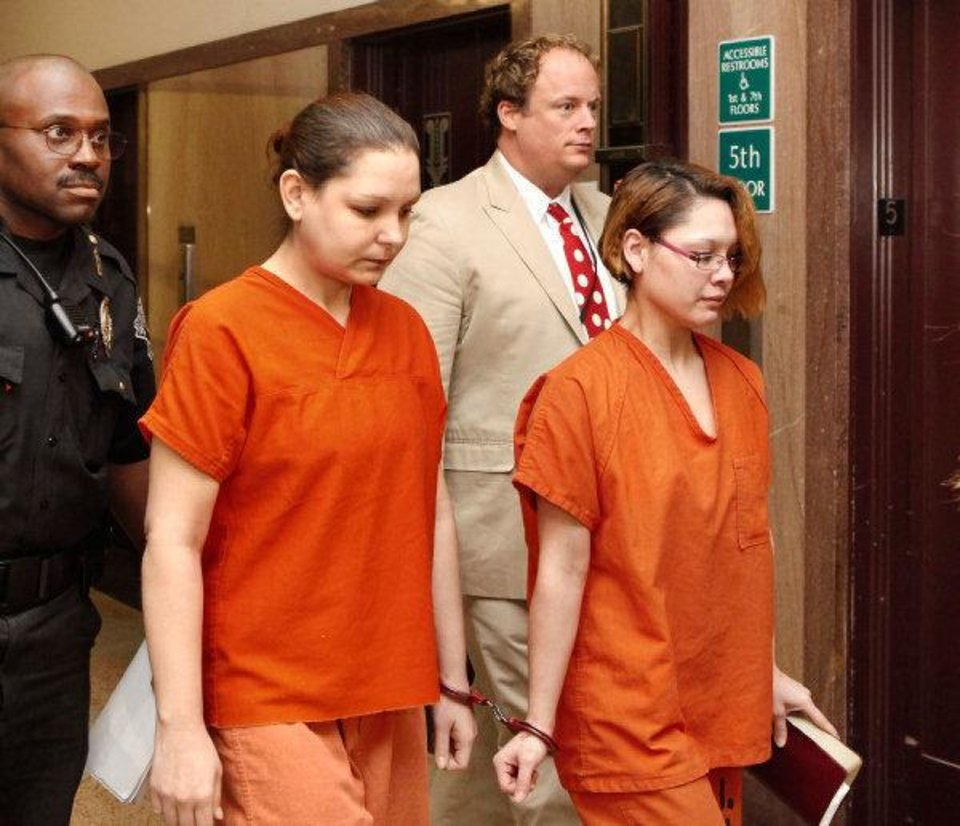 Lorena Amanda Hodges, left, and Kimberly Sue Vergara walk to court Tuesday for their sentencing. Vergara is clutching a Bible. <strong>JIM BECKEL - THE OKLAHOMAN</strong>