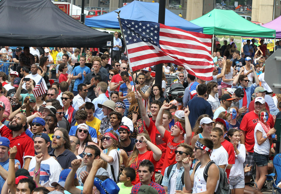 Photo - Thousands of USA fans in Buffalo, N.Y. on Thursday, June 26, 2014, react to the USA advancing to the next round of the World Cup after their 1-0 loss to Germany. The large crowd watched the game on large screen TVs at Canalside in Buffalo.   (AP Photo/The Buffalo News, James P. McCoy)  TV OUT; MAGS OUT; MANDATORY CREDIT; BATAVIA DAILY NEWS OUT; DUNKIRK OBSERVER OUT; JAMESTOWN POST-JOURNAL OUT; LOCKPORT UNION-SUN JOURNAL OUT; NIAGARA GAZETTE OUT; OLEAN TIMES-HERALD OUT; SALAMANCA PRESS OUT; TONAWANDA NEWS OUT