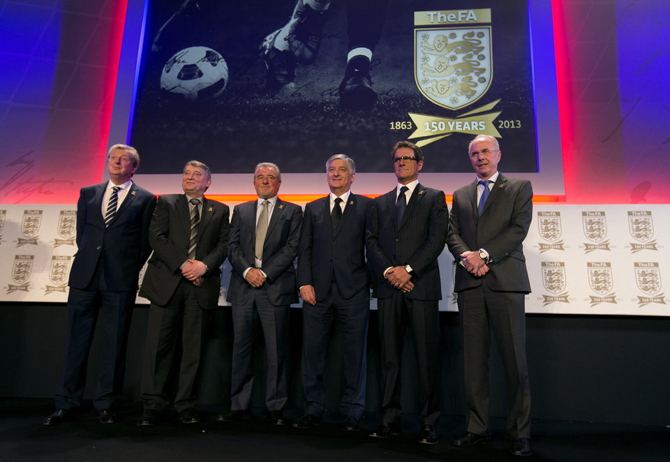 The current and some former England soccer team managers pose for photographs at the launch of the English Football Association's150th anniversary year in central London, they are from the left- Roy Hodgson, the current manager, Graham Taylor, Terry Venables, David Bernstein Chairman of the FA, Fabio Capello and Sven-Goran Eriksson, Wednesday, Jan. 16, 2013. The English FA was founded in London in October 1863, it was instrumental in forming the modern day game of soccer.(AP Photo/Alastair Grant)