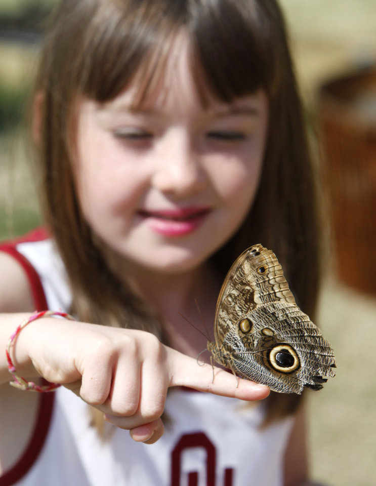 Six year old Raelynn Dodd holds a butterfly at the Butterfly House at the Oklahoma State Fair at State Fair Park in Oklahoma City, OK, Thursday, September 20, 2012,  By Paul Hellstern, The Oklahoman