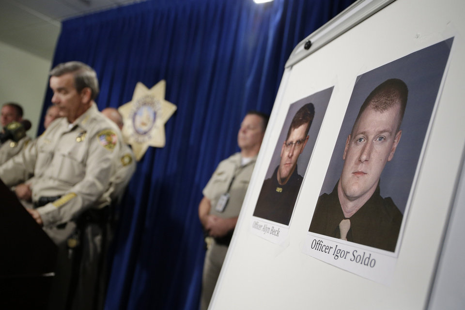 Photo - Sheriff Doug Gillespie, left, speaks at a news conference on the shooting of two Las Vegas Metropolitan Police Department officers Sunday, June 8, 2014 in Las Vegas. The two officer killed were Alyn Beck and Igor Soldo. (AP Photo/John Locher)