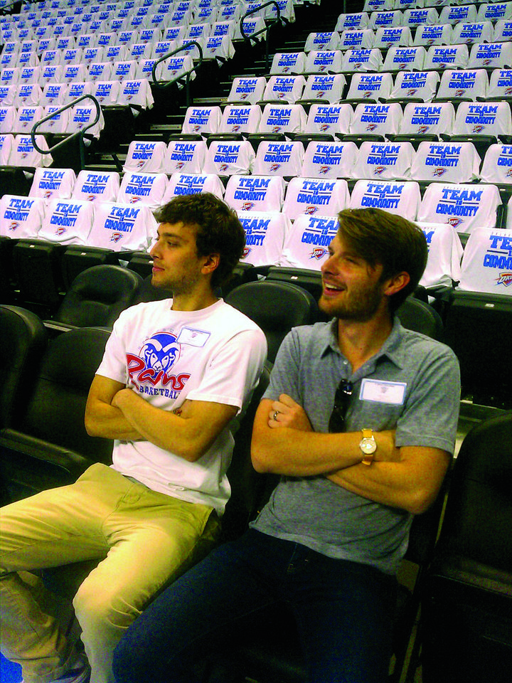 Photo - Blake deBernard and Ethan Sperle, members of Quail Springs Baptist Church, rest after prayer walking as they placed Oklahoma City Thunder playoff T-shirts on seats at the Chesapeake Energy Arena. Photo provided by The Baptist Messenger