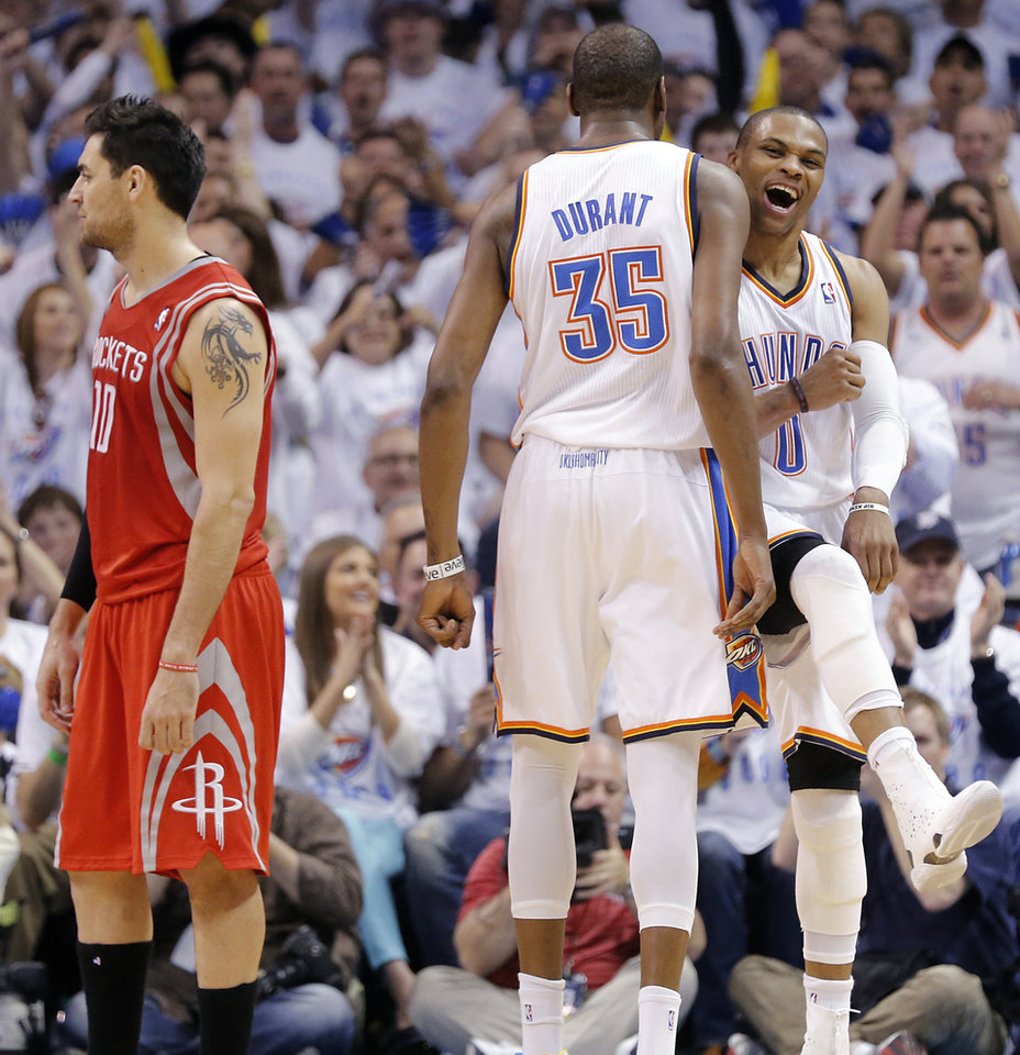 Photo - Oklahoma City's Kevin Durant (35) and Russell Westbrook (0) celebrate next to Houston's Carlos Delfino (10) during Game 2 in the first round of the NBA playoffs between the Oklahoma City Thunder and the Houston Rockets at Chesapeake Energy Arena in Oklahoma City, Wednesday, April 24, 2013. Photo by Chris Landsberger, The Oklahoman