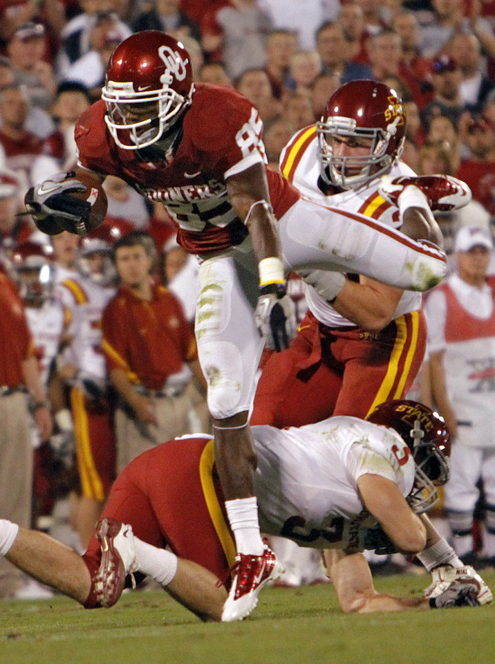 Oklahoma's Ryan Broyles (85) leaps over Iowa State's Zac Sandvig (3) during the first half of the college football game between the University of Oklahoma Sooners (OU) and the Iowa State Cyclones (ISU) at the Gaylord Family-Oklahoma Memorial Stadium on Saturday, Oct. 16, 2010, in Norman, Okla.  Photo by Chris Landsberger, The Oklahoman ORG XMIT: KOD