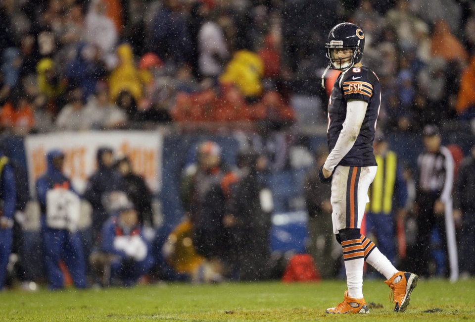 Photo -   Chicago Bears quarterback Jay Cutler (6) walks off the field during a break in the action against the Houston Texans during the first half an NFL football game, Sunday, Nov. 11, 2012, in Chicago. (AP Photo/Nam Y. Huh)
