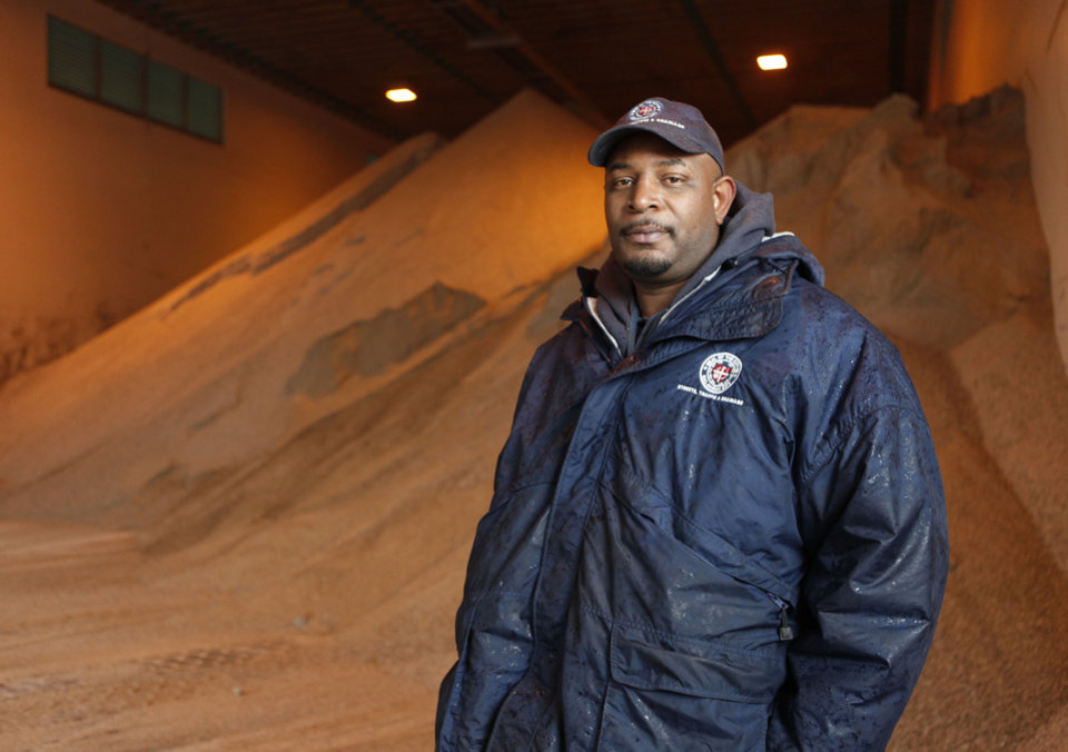 Photo - Kevin Lewis is a salt truck driver for Oklahoma City, Thursday, Jan. 28, 2010. By Paul Hellstern, The Oklahoman