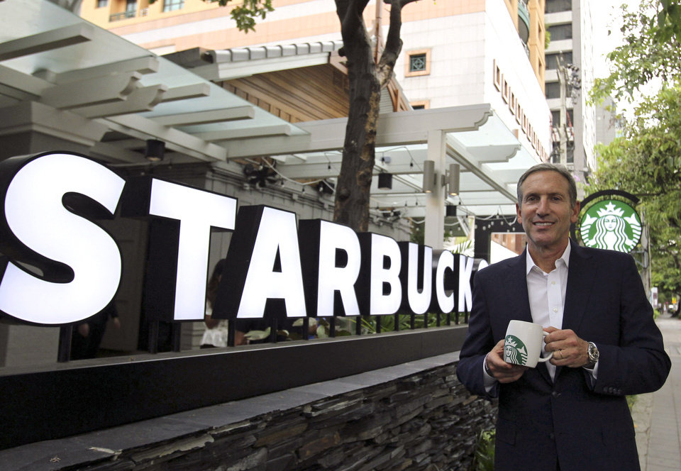 Starbucks CEO Howard Schultz poses for the photographer before a press conference in Bangkok, Thailand, Monday, May 13, 2013. Schultz, visiting Bangkok this week to mark the coffee giant's 15 year anniversary of opening in Thailand, said Monday the coffee chain's first stores in India and Vietnam have been received positively and it might soon be time to give Myanmar a shot too. (AP Photo/Sakchai Lalit)